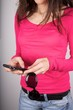 woman pink shirt detail holding sunglasses and smartphone