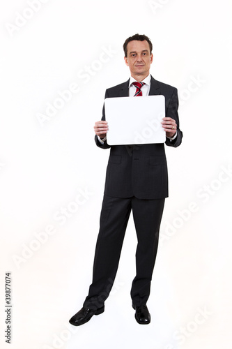 Business man with sign or board