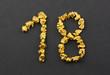 Zahl 18 aus Goldnuggets