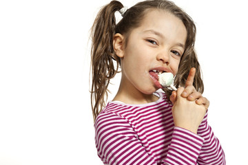Girl with a lollipop, isolated on white background