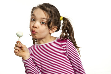 Little girl with a lollipop, isolated on white background
