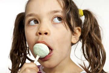 Close-up of little girl with a lollipop