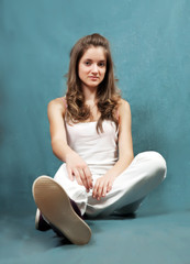 girl sitting on grey