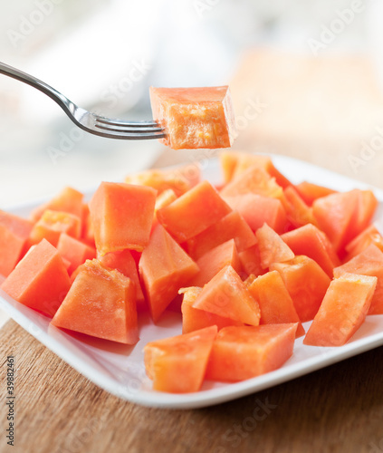 Papaya on white dish