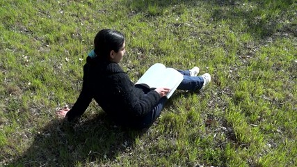 girl studying on the meadow