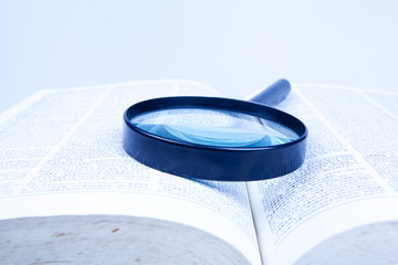 book with a magnifier lens