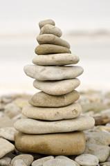 pile of stones balanced at winter beach
