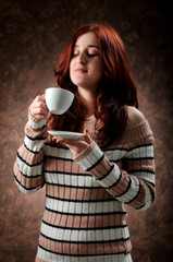Woman hold a cup of coffee