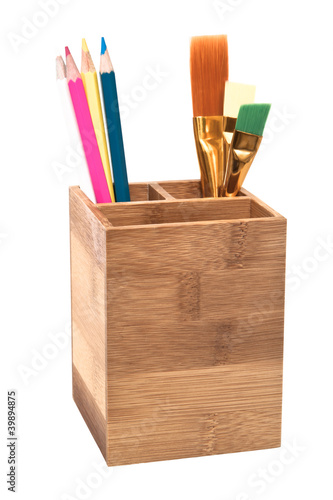 Pencils in wooden holder isolated on white