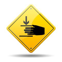 Señal amarilla simbolo aplastar mano