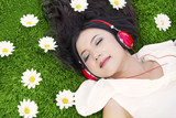 Beautiful woman listens to music outdoor