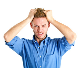 Angry businessman pulling his hair isolated on white