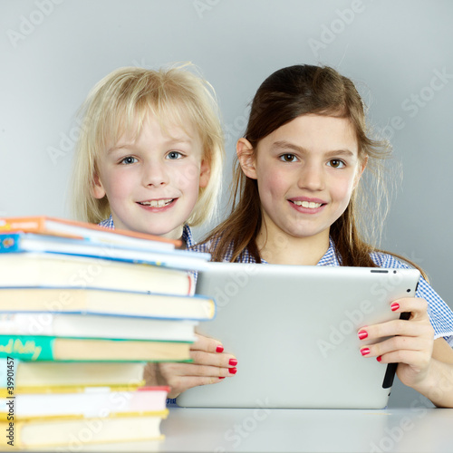Twogirlfriends learn together with books and touchpad