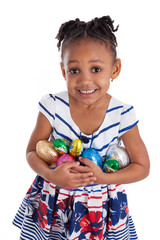 Little african american girl holding chocolate easter eggs