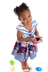 Little african american girl eating chocolate easter egg