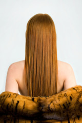 Beautiful young red-haired woman with long beauty straight hair