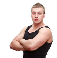 One handsome musculan man with clasped hands on white background