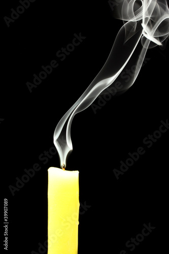 Photo: candle with abstract smoke on black background