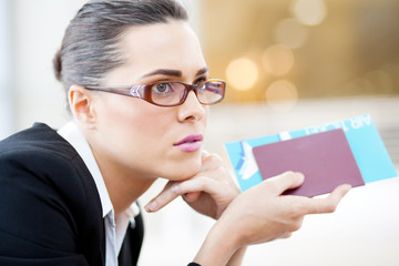 closeup of young businesswoman waiting for her flight in airport