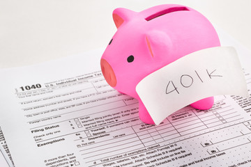 Piggy bank and tax forms