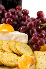 Crackers with grapes, brie, and some clementins