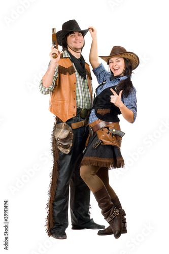 Cheerful young cowboy and cowgirl