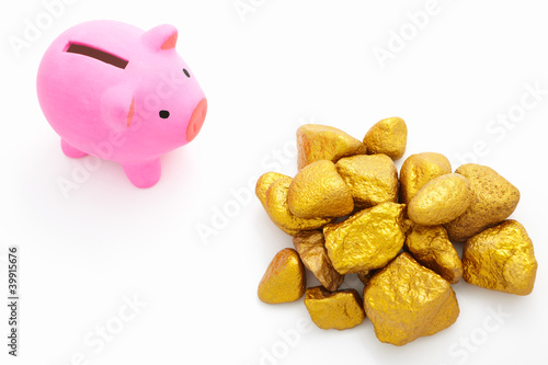 Piggy bank and gold