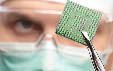 Scientist examining a microchip.