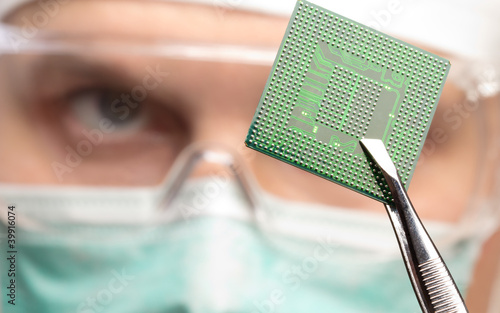 Scientist examining a microchip.