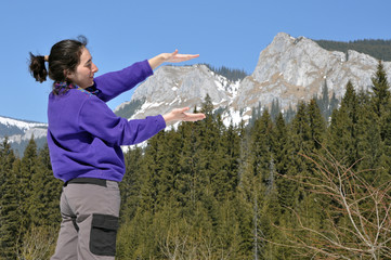 Woman playing in the mountains in early spring