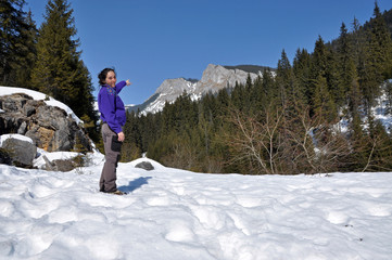 A trekking girl in the snowy mountains in the Carpathians, Roman