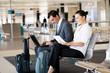 Leinwanddruck Bild - business travellers waiting for their flight at airport