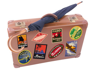 ter Reisekoffer und Regenschirm
