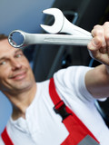 Close up of a motor mechanic with work tools in a garage