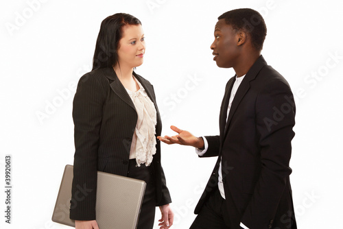 Business people in conversation mixed race