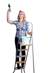 girl on ladder with paint
