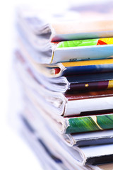 Stack of magazines isolated, close up