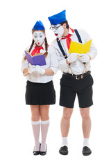 two mimes with books