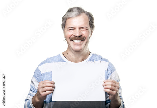 mature man holding a blank billboard isolated on white