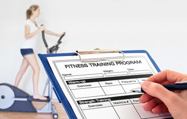 In the Gym - a fitness trainer completes a program for a client
