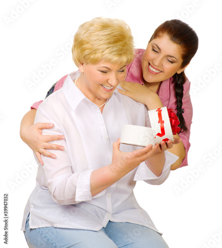 Young woman give gift to her mother