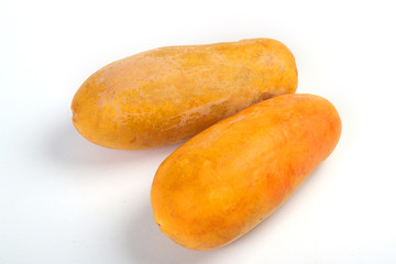 The orange papaya has not been peel on a white background