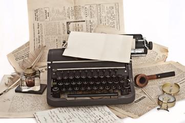 pipe and vintage typewriter