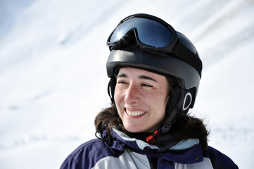 Portrait of a smiling skier woman with helmet