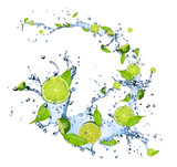 Limes pieces falling in water splash on white background