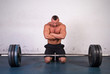 Strong man preparing to lift a heavy dumbbell