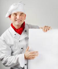 Smiling chef holding menu