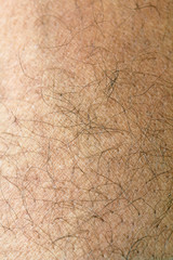 Human skin with strands of hair close up