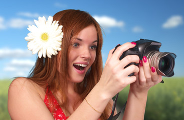 Photographer woman holding camera