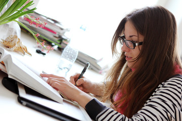Beautiful girl studying at home